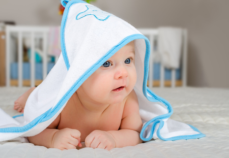 after the bath: Cute little baby boy in a hooded towel after bath