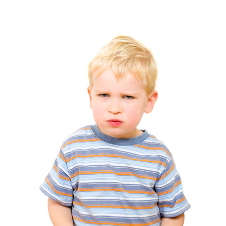 grouchy: Angry and serious beautiful boy isolated on white background