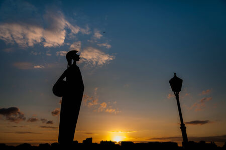 minerva: Silhouette of the Minerva statue at sunset in Antwerp, Belgium