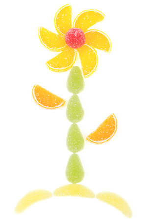 Flower made by pieces of marmalade isolated over white background photo