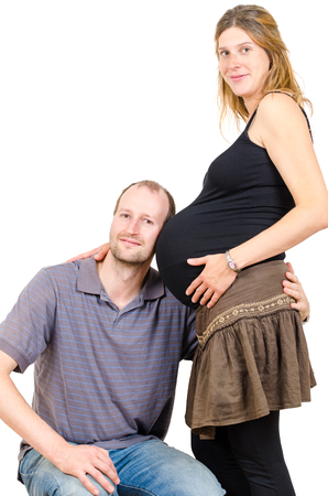 Happy man embracing beautiful pregnant woman isolated on white background
