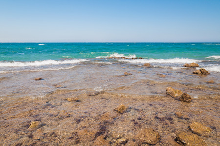 Beautiful azure red sea with waves and rocks and clear blue sky in Egypt photo