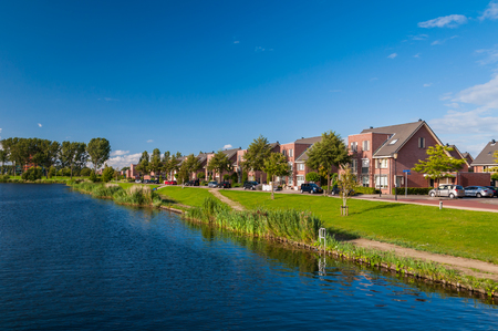 Peaceful and quiet suburban area with modern expensive houses on lake in Europe photo