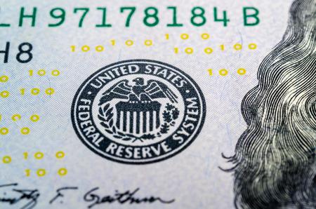 Federal reserve system symbol on hundred dollar bill closeup macro shot Stock Photo