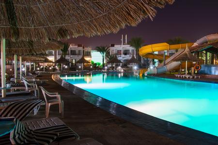 Swimming pool at a luxury resort at night