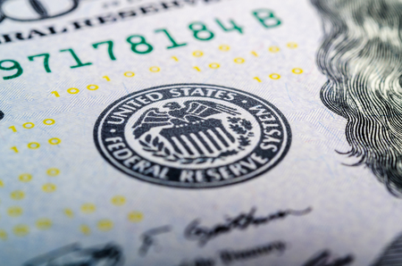 Federal reserve system symbol on hundred dollar bill closeup macro shot Stock Photo