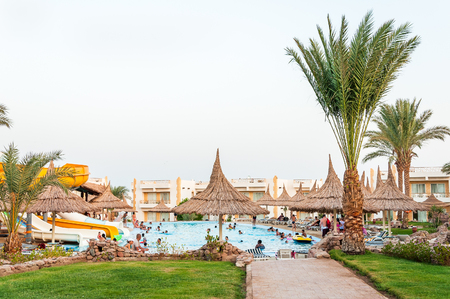 A resort swimming pool in the morning with visitors