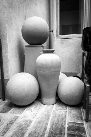 Unfinished ceramic pot and sphere shapes in the pottery workshop