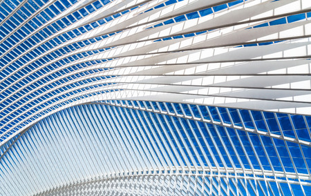 Transparent ceiling in modern railway station with blue sky on a background Imagens