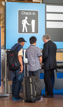 Group of people are checking in for the flight in the airport Imagens