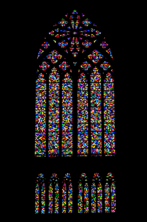 Colorful mosaic stained glass window of gothic church