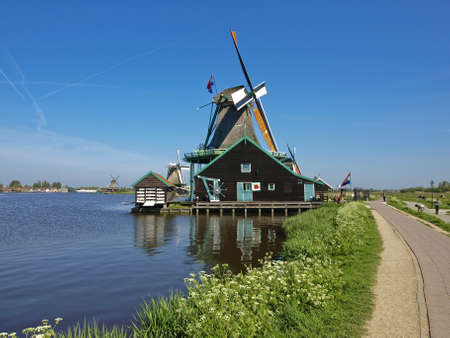 Ethnographic Museum of the province of North Holland - Zaanse Schans  Windmills on the lake  A sunny day