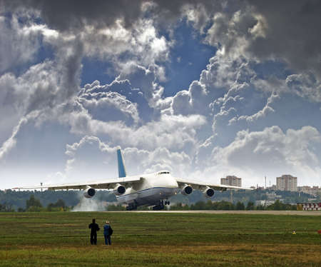 a large cargo plane breaks away from the runway  People look at the airplane