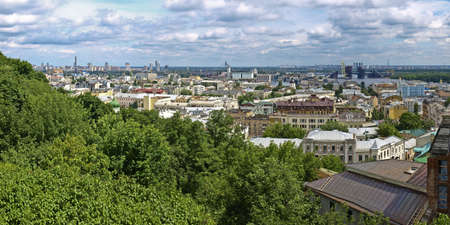 Panorama district of Kiev  Hem and Obolon against the cloudy sky  In the foreground is a green park area  Stock Photo