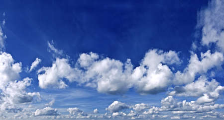 The sky with white and gray cumulus and cirrus clouds  On top of the blue sky  Stock Photo