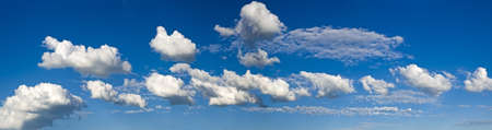 strip of white cumulus clouds in the pure blue sky  As clumps of cotton wool Stock Photo