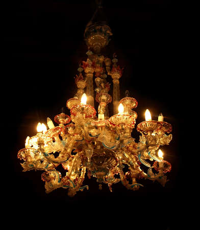 antique beautiful chandelier of colored Murano glass. Chandelier on. On a dark background.