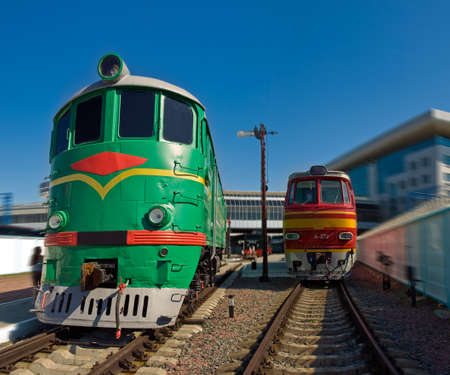 Red and green locomotives depart from the station  Railway Museum, Kyiv, Ukraine Editorial