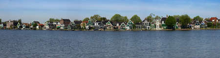Ethnographic Museum of the province of North Holland - Zaanse Skansen. Traditional wooden houses along the river bank. Stock Photo - 17861762