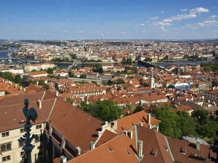 Panorama of Prague from the bell tower of the Cathedral of St. Vitus in the direction of Old Town. Tiled roofs, the river and bridges. photo