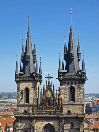 Two towers of The Church of Our Lady Before Tyn in the background of the clear blue sky. Stock Photo - 17861742