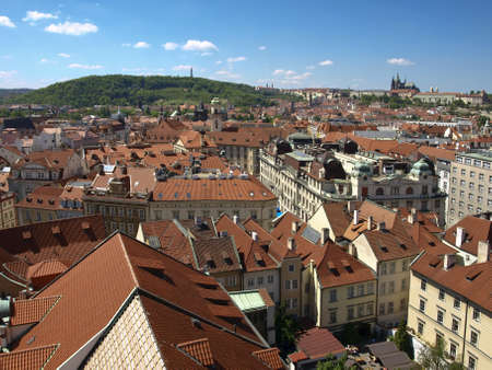 View from the Old Town Hall in the direction of Prague Castle and Petrin. Prague, Czech Republic. Red tiled roofs. On the horizon, St. Vitus Cathedral and the Petrin View Tower on the hill. Stock Photo - 18140679