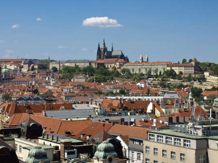 The view from the tower of the Old Town Hall in the direction of Prague Castle and St. Vitus Cathedral. Prague, Czech Republic. Stock Photo - 18140673