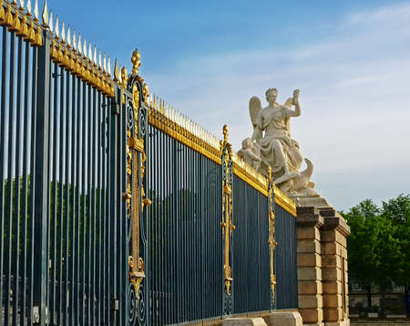 Palace of Versailles, France  The main entrance  Lattice fence with gold-plated details  Sculpture - allegory  Stock Photo - 18193913