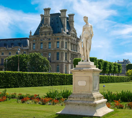 Tuileries. Sculpture of a woman with a dog on the background of the Louvre. Paris, France. Stock Photo - 18244580