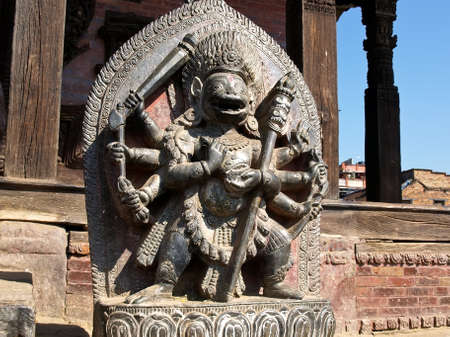 sculpture demigoddesses Singhini (lioness goddess) on the upper terrace in front of Nyatapola temple in Bhaktapur, Nepal.