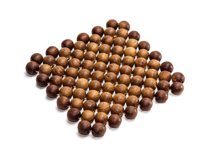 trivet: Stand under the hot dishes in the form of a rug made of wooden beads made of juniper