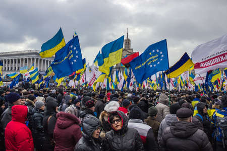 Kyiv, Ukraine, December 8, 2013: People and flags at the meeting for the European integration and the resignation of the government in the center of Kiev.