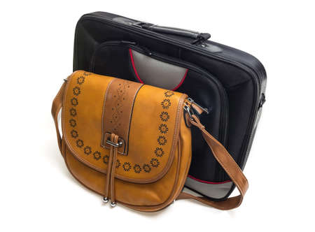 garniture: Womens bag of yellow skin and black laptop bag on a light background Stock Photo
