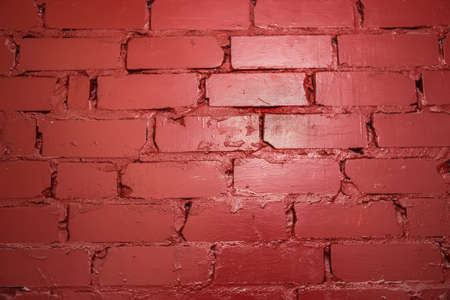 colouration: Background of brick wall not plastered, painted with red paint Stock Photo