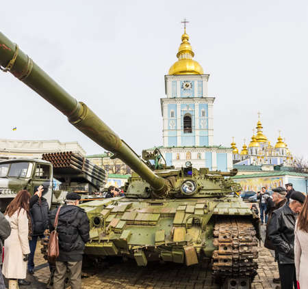 The tank on the background of Michaels Monastery. Exhibition of Russian weapons, brought from the combat zone in the Donbass. Kiev, Michaels Square, February 2015 Stok Fotoğraf - 37133355