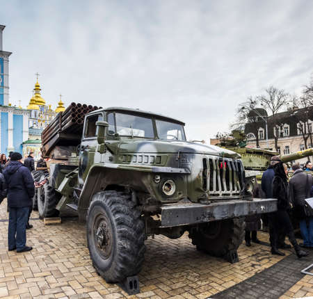 Multiple rocket launchers BM-21 Grad against the background of Michaels Monastery. Exhibition of Russian weapons, brought from the combat zone in the Donbass. Kiev, Michaels Square, February 2015