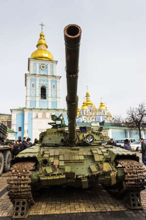 temple tank: The tank on the background of Michaels Monastery. Exhibition of Russian weapons, brought from the combat zone in the Donbass. Kiev, Michaels Square, February 2015