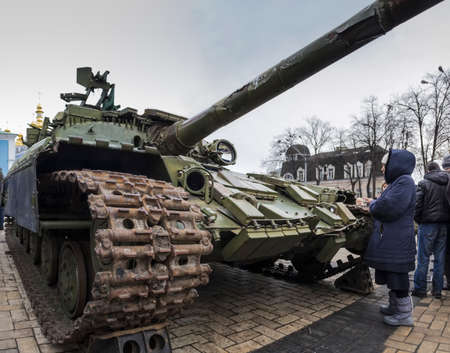 war crimes: The tank on exhibition of Russian weapons, brought from the combat zone in the Donbass. Kiev, Michaels Square, February 2015 Editorial