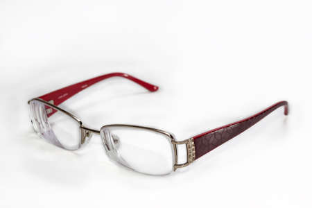 viability: womens glasses in an elegant rimmed on a light background