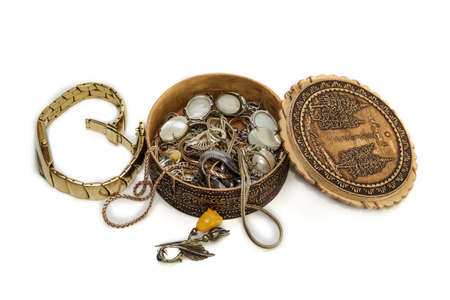 ajar: womens watches and ajar wooden round casket with jewelry and bijouterie on light background