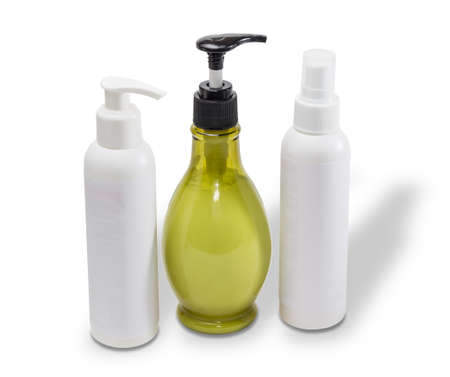 maquillage: Two white and one bottle of olive color with cosmetics on a light background Stock Photo