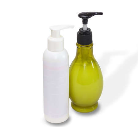 chiropody: Two bottles white and of olive color with cosmetics on a light background Stock Photo