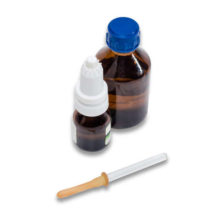 malaise: Pipette and two bottles with medicines on a light background. Isolation.