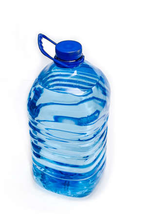 Large blue plastic bottle with drinking water on a light background. Isolation.