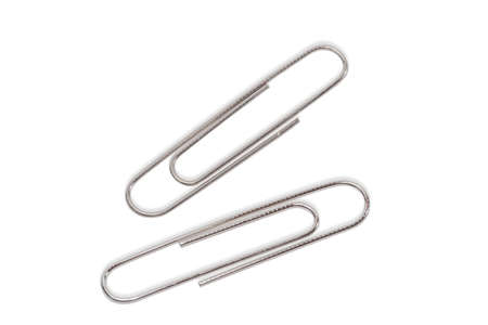 Two large paper clip on a light background. Isolation.