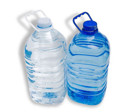 safe drinking water: Two large plastic bottle with handles with drinking water - one transparent bottle and one blue on a light background. Isolation.