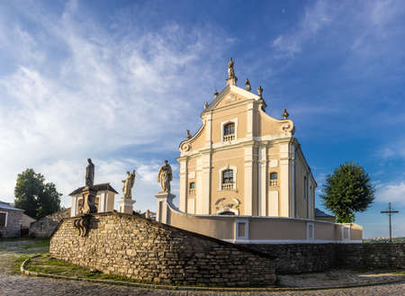 sacred trinity: Trinity catholic church of the 18th century baroque. Ensemble of the monastery the early morning. Kamenetz-Podolsk, Ukraine.