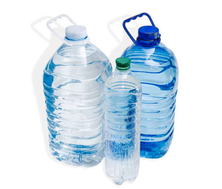 safe drinking water: Two large plastic bottle with handles and one little bottle with drinking water on a light background. Isolation.
