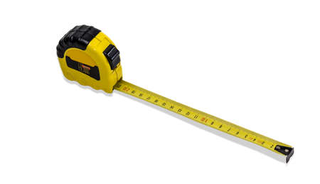 Yellow tape measure to measure the dimensions of the metric system with pulled out tape on light background.  Isolation.
