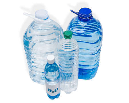 safe drinking water: Several different sizes of bottles with drinking water on a light background. Isolation.